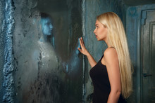 Frightened Young Woman Looking To The Mirror And Seeing In Reflection A Ghost Girl