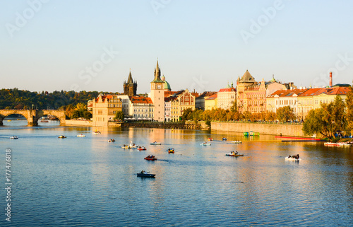 Staande foto Praag Cityscape of Prague old town, its towers, Vltava river, Charles bridge, St. Francis of Assisi church. One of the most famous areas of Czech Republic capital