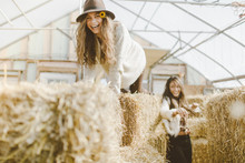 Girl Climbs On Hay Stacks In F...