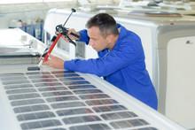 Fitter Applying Sillicone Around Solar Panel
