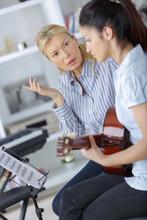 Music Teacher Reprimanding Guitarist