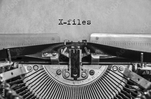 Photo  X-files, classified materials are printed on an old vintage typewriter