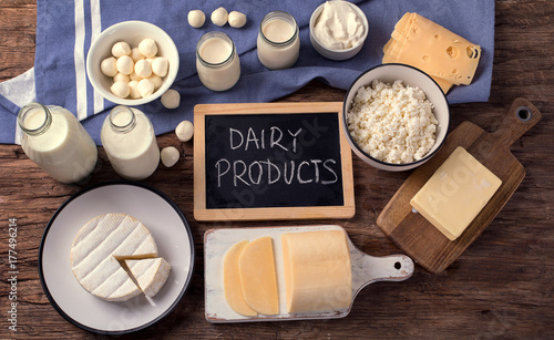 Poster Dairy products Dairy products on wooden background.
