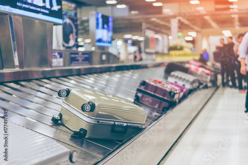 Fotografie, Obraz  Suitcase or luggage with conveyor belt in the airport.
