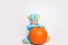 Baby Dressed Up For Halloween In A Monster Costume