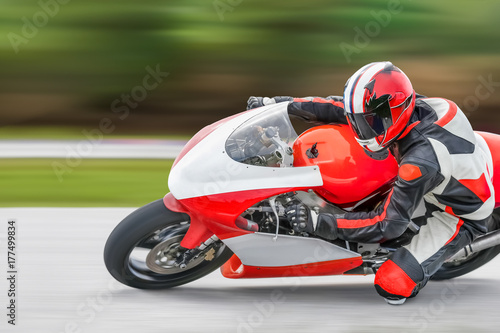 Photo sur Toile Motorise Motorcycle practice leaning into a fast corner on track