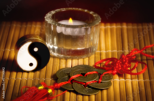 Yin yang, oriental chinese lucky coins, a candle like a concept for