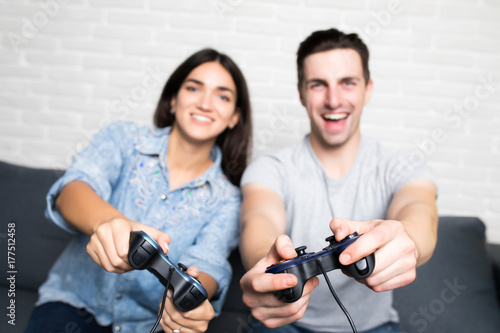 Young Cute Couple Playing Video Games Looking At Camera In Livingroom At Home Buy This Stock Photo And Explore Similar Images At Adobe Stock Adobe Stock