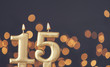 canvas print picture - Gold number 15 celebration candle against blurred light background