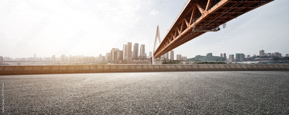 empty asphalt road with modern bridge and buildings