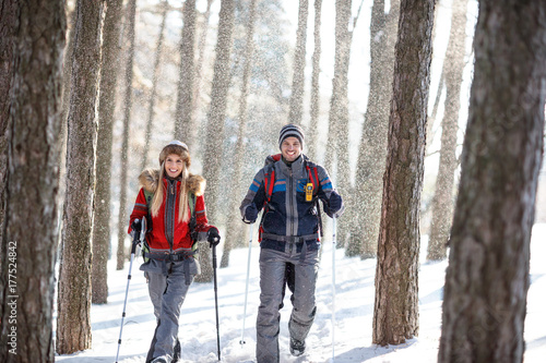Hikers on snowy winter hiking on mountain Wallpaper Mural