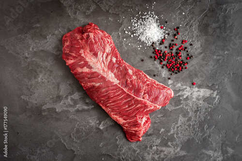 Garden Poster Steakhouse Hanging Tender steak on a stone background with salt and pepper - onglet steak