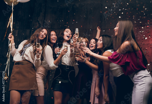 girls make a new year wish and drinking champagne happy group of attractive girls dancing