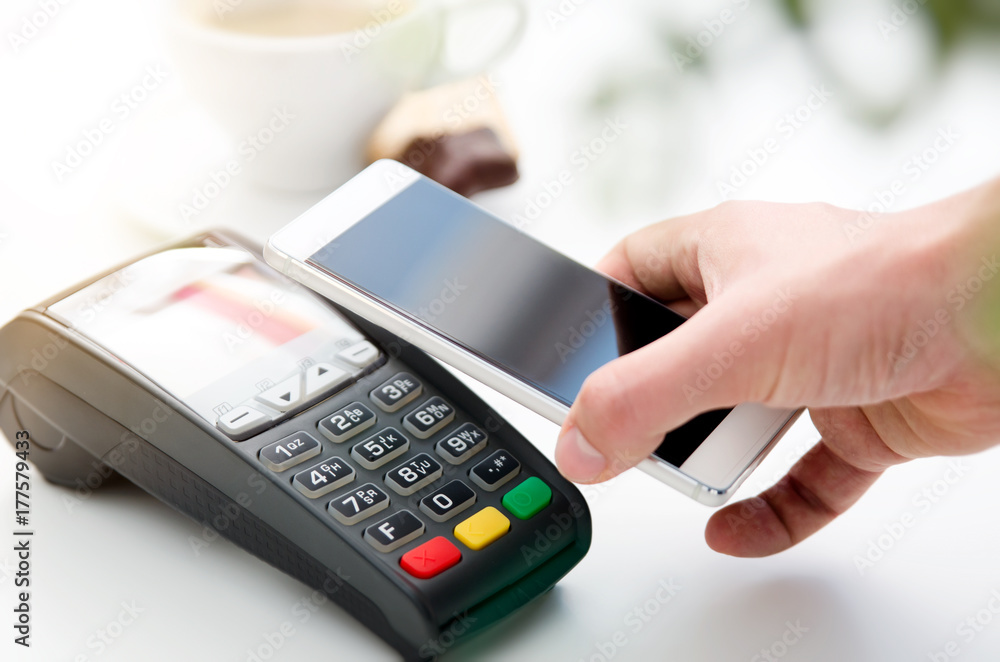 Fototapeta Mobile payment in cafe with smart phone