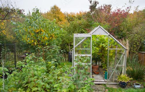 Greenhouse in autumn Tableau sur Toile