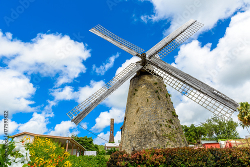 Photo Stands Mills The Morgan Lewis Mill in Barbados - on tropical caribbean island - was the last working mill on the island and was believed to be built in 1727. Travel destination on island.