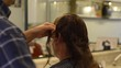 Men's hairstyling and haircutting in a barber shop or hair salon