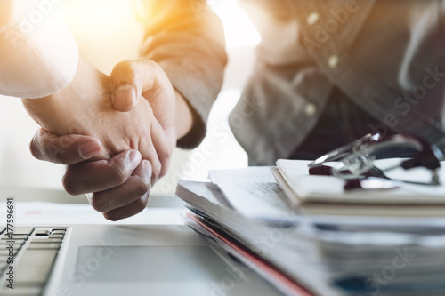 Close up of Business people shaking hands, finishing up meeting, business etiquette, congratulation, merger and acquisition concept