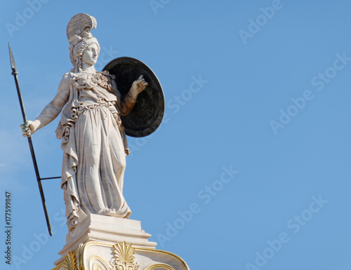 Athena statue on blue sky background, ancient greek godess of knowledge and wisd Canvas Print