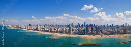 Fotografia Tel Aviv skyline off the shore of the Mediterranean sea - Panoramic aerial image
