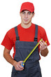 Handyman worker with measuring tape