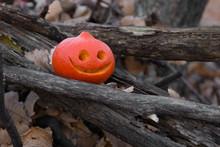 Halloween Jack-o-lantern Pumpkins On A Dark Wooden Background