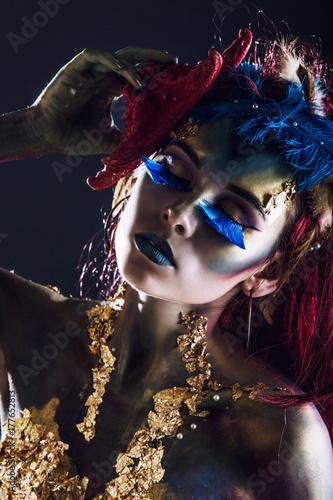 Woman beautiful model with body art unusual fancy in the Studio