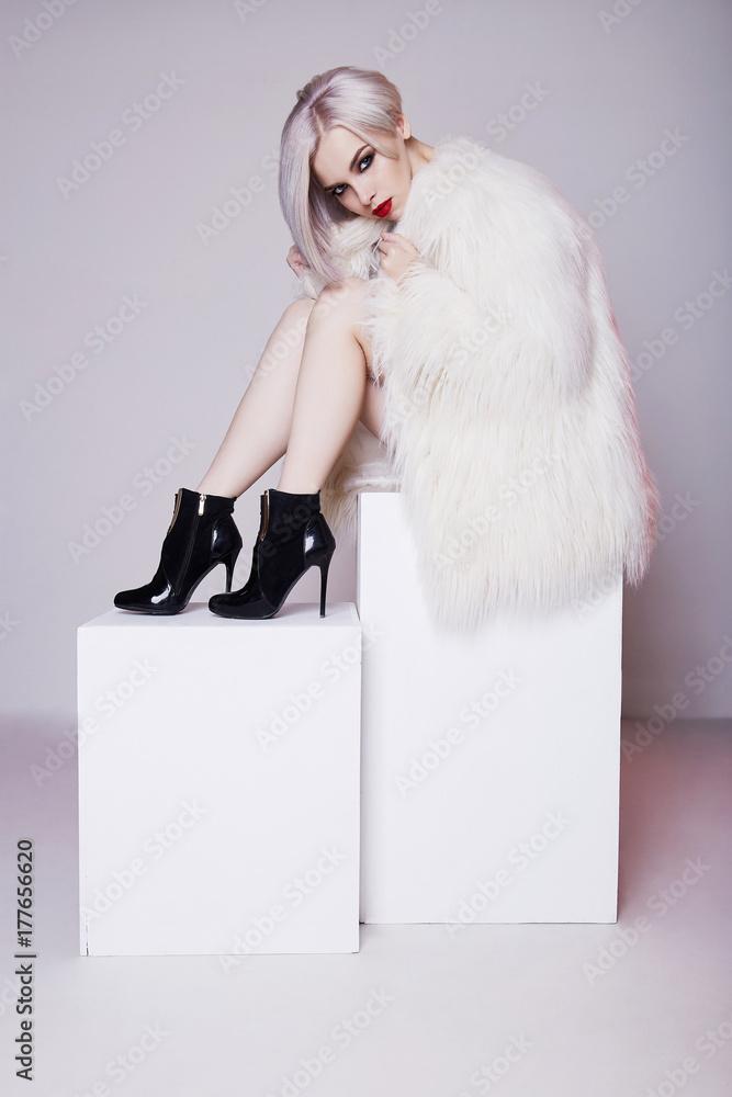 Fototapeta Beautiful blond young woman in fur