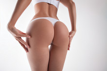 Slender Round Female Buttocks ...