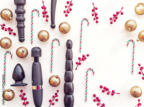 sex toys golden christmas balls candies and branches with red berries are on a - Christmas Sex Toys