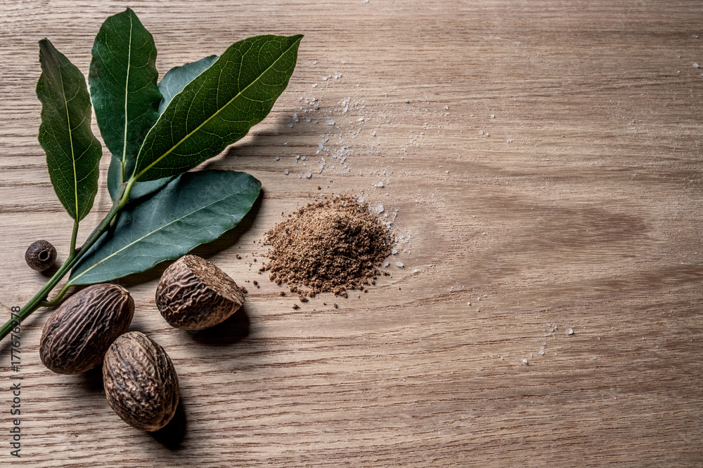 Fototapety, obrazy: Nutmeg and bay leaf on wooden table