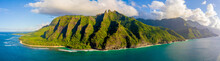Amazing Aerial View Of The Na Pali Coast Cliffs From Above. Beautiful Pacific Ocean, Sunlight And Green Cliffs Of The Hawaii Islands.
