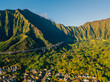 """Kualoa Ranch in Oahu, Hawaii. Many famous television shows and movies, including """"Jurassic Park"""" and """"Lost"""" were filmed in Kualoa Ranch. Also famous stairs to Heaven or Haiku stairs cliffs."""