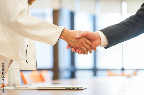 Fototapeta close up investor businessman handshake with partner vendor,collaboration of two ceo leader hand shake for agreement or deal financial cooperative concept. obraz