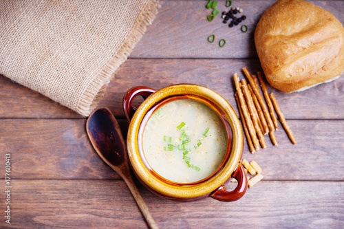 Cheese soup, bread sticks and bun
