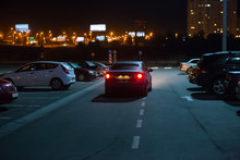 Cars At Night In A Parking Lot