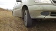 Emergency road situation / Car was stuck in the pit on dirt road, wheel slipping on dry dirt