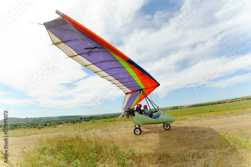 Beautiful color hang-glider soars into the sky