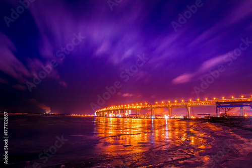 Cadres-photo bureau Violet Flying clouds at night. Winter landscape. Industrial landscape.