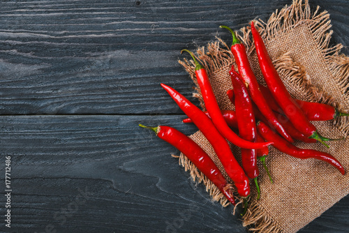 Chili red pepper. On a wooden background. Top view. Free space for your text.
