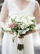 canvas print picture - wedding bouquet in bride's hands