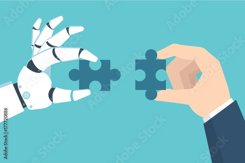 Photo  Robot and Businessman Hand holding puzzle