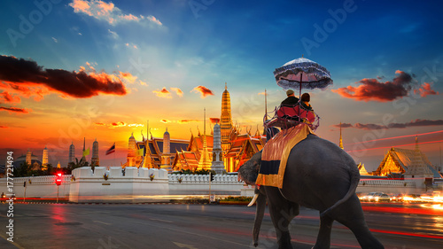 Photo Stands Bangkok An Elephant with Tourists at Wat Phra Kaew -the Temple of Emerald Buddha- in the Grand Palace of Thailand in Bangkok
