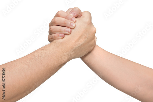 Fotografía  Two hands in a wrestling arm. Isolated white background