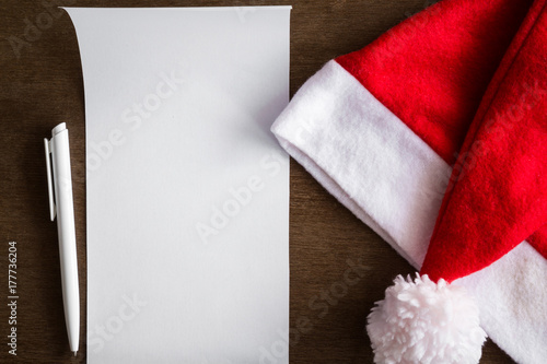 White paper sheet pen and red hat letter to santa claus from white paper sheet pen and red hat letter to santa claus from children and spiritdancerdesigns Gallery