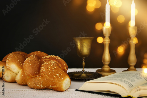 shabbat image. challah bread, shabbat wine and candles on the table