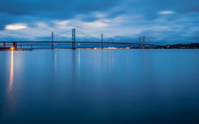Forth Road Bridges At Night / Queensferry Crossing A Road Bridge In Scotland, Built Alongside The Existing Forth Road Bridge Across The Firth Of Forth Between South And North Queensferry