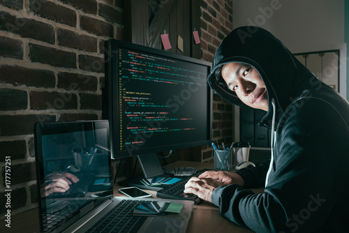 evil young computer programmer as hacker