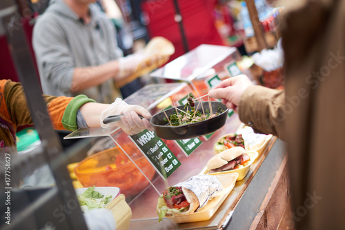 Vászonkép Street vendor offering taste samples on a pan in Camden