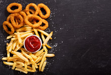 Onion Rings And French Fries With Ketchup